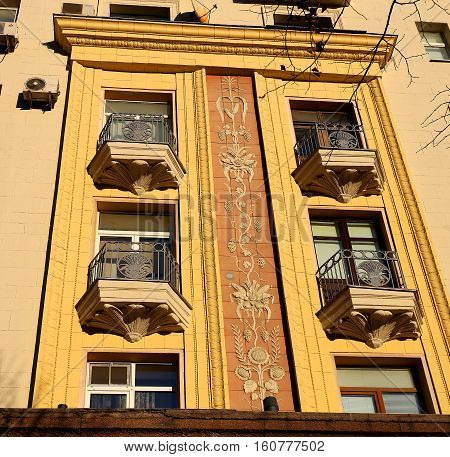 Beautiful building in Moscow with a color pattern between the balconies to photograph closeup