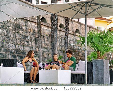 People In Street Restaurant In Ascona Town Of Switzerland