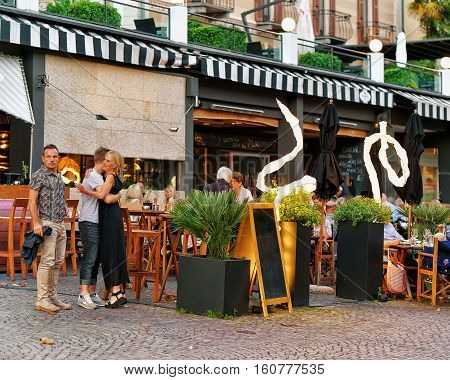 People Relaxing And Dining At Street Restaurants Of Ascona