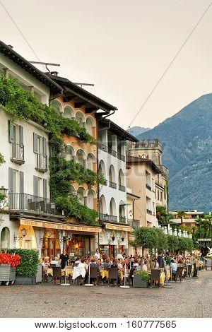 People Relaxing In Street Restaurant In Ascona In Swiss