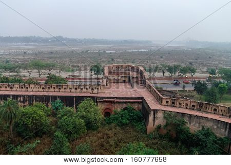 View Of Walls Of Red Fort In Agra With Dry Yamuna River,  Agra, Uttar Pradesh. India