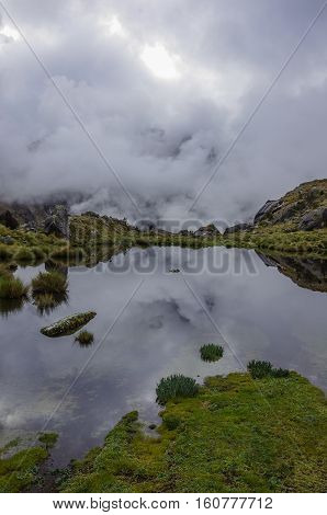 Clouds Reflection In Mountain Lake Near Punta Union Pass. Huascaran National Park, Cordillera Blanca