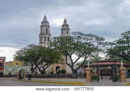 Independence Plaza with cathedral on the opposite side of the square. Campeche Mexico