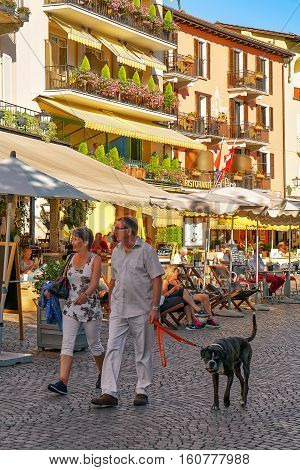 Tourists With Pet During Promenade In Ascona