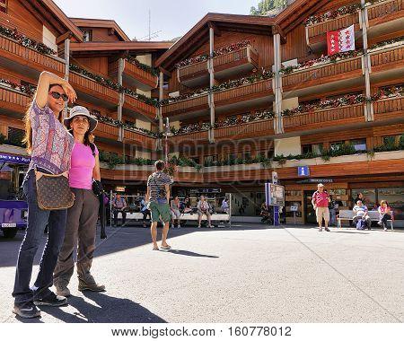 Travelers At Tourist Information Office In City Center In Zermatt