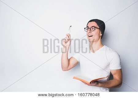 Handsome Male Student Holding Notebook