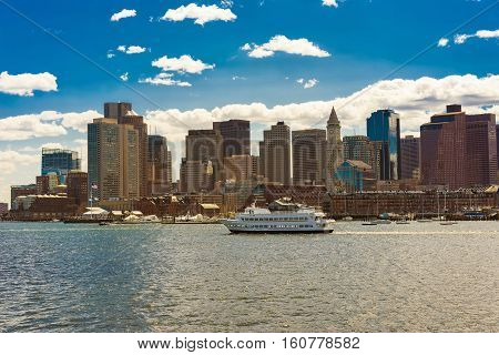 Boston Skyline And Ship Floating Across The River