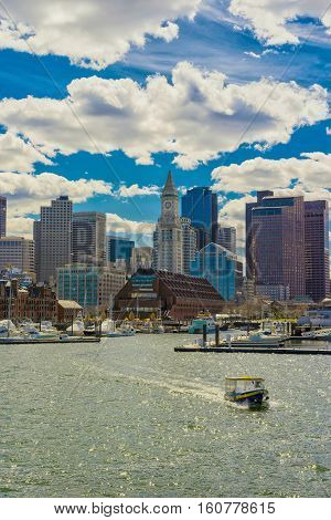 Boston Skyline And The Ferry Boat Floating Across The River