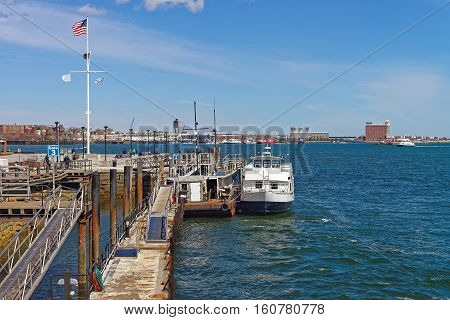 Pier Of Boston Wharf With Sailboat And Charles River