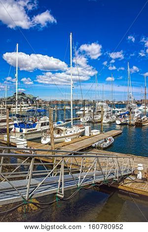 Pier Of Long Wharf And Sailboats In Boston