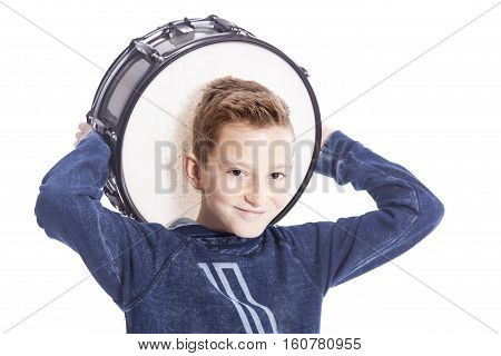teenage boy and drum in studio against white background