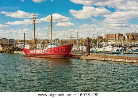 Boston USA - April 29 2015: Red moored ship near the pier in Boston USA. The Port of Boston is one of the most important seaports in the east coast of the United States.