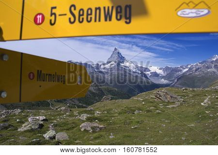 trekking signboards in swiss alps during summer