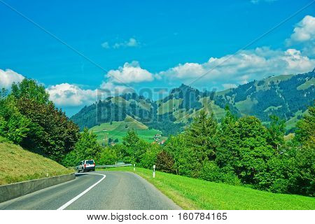 Road and Prealps mountains in Gruyere district Canton Fribourg in Switzerland