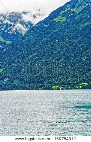Sailboat In Lake Brienz And Brienzer Rothorn Mountain Bern Swiss