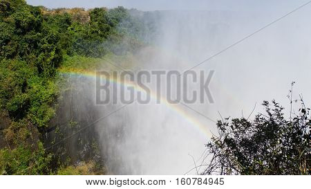 A rainbow in the spray of Victoria Falls in Zambia