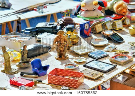 Ascona Switzerland - August 23 2016: Various goods for selling at the counter in the flea street market Ascona Lake Maggiore Ticino canton Switzerland.