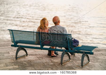 Couple Sitting On Bench In Ascona Swiss