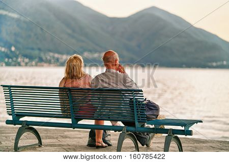 Couple Sitting On Bench In Ascona Of Swiss