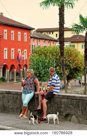 Tourists With Pet At Promenade In Ascona