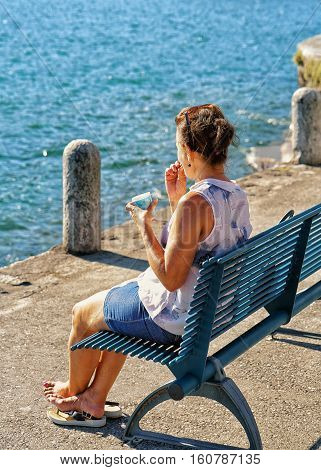 Woman Sitting On Bench Of Ascona Expensive Resort