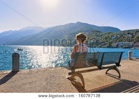 Woman Sitting On Bench At Ascona Expensive Resort