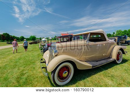 Milton, Ontario, Canada, June 18, 2016, car show in the Country Heritage Park, side view of classic vintage car with people in background