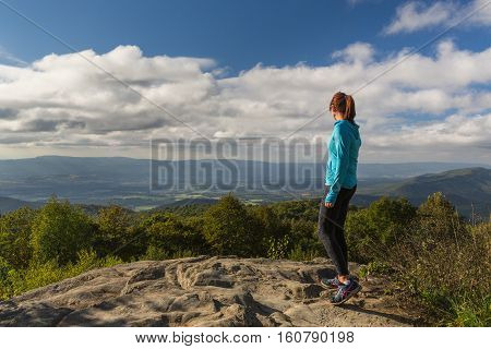 This woman has this inspirational view across the valleys and mountains below in Shenandoah National Park