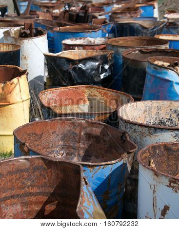 Abandoned and empty oil barrels lined up in Redmond in Central Oregon on a Spring day.