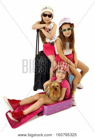 Little fashionable girls with small yorkie ready for vacations