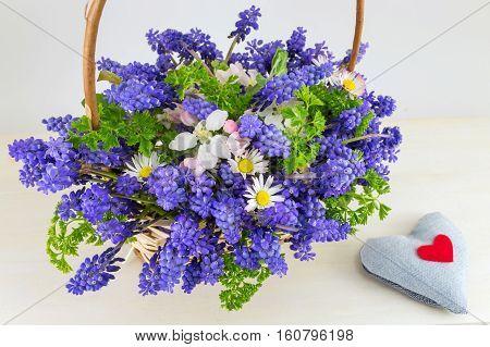 Bluebell flowers bouquet in a wicker basket