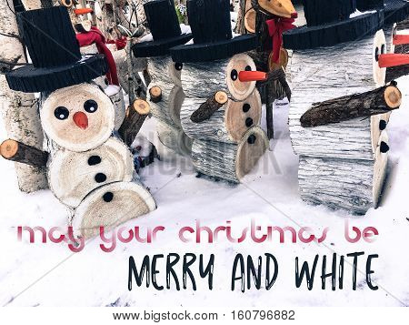 May your Christmas be Merry and White Christmas winter social media image, greeting card or background with snowman decorations in snow and written holiday greeting in red and black