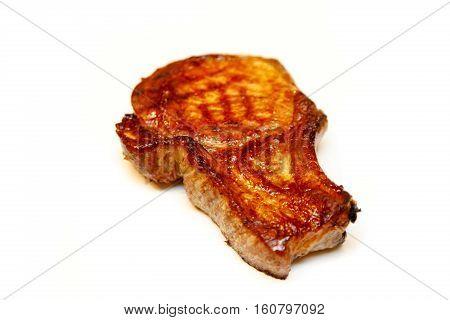 Roasted Pork Loin On The Bone Is Cut Into Steaks  A White Back