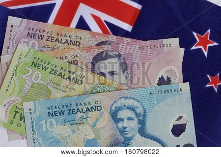 New Zealand flag and dollar notes together.