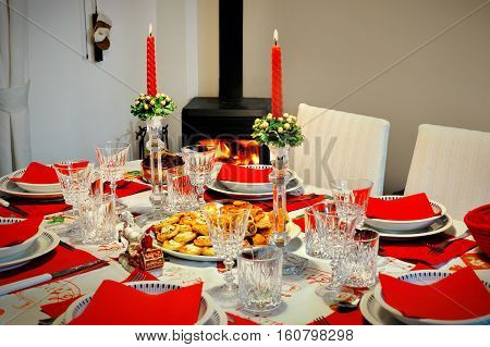 New Year's holidays table in a room with a fireplace