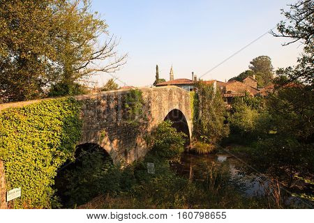 View of the Mediaeval bridge in Furelos Spain