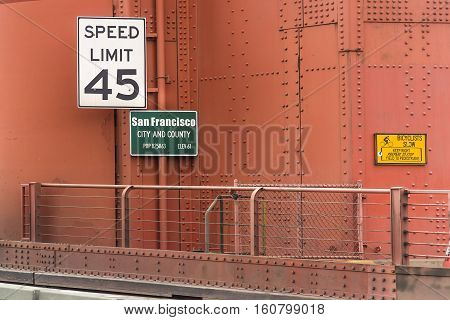 Speed limit and population indication signs on Golden gate Bridge in San Francisco