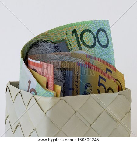 A basket full of Australian dollar notes.