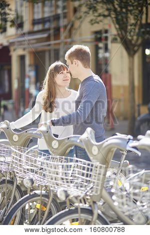 Happy Romantic Couple Of Tourists Taking Bikes For Rent In Paris