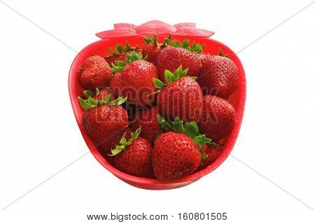 Fresh strawberries in a strawberry-shaped bowl. Isolated on white.