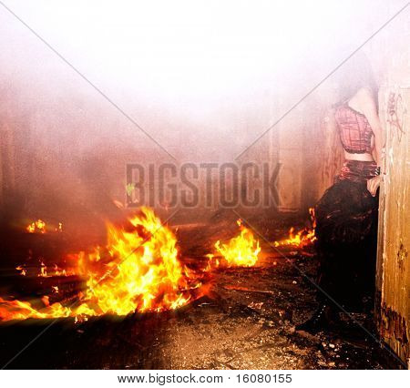 Young woman and fire in old house