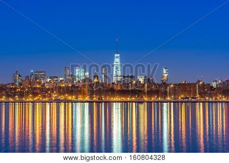 Lower Manhattan and the east river in early morning dawn with the One World Trade Center