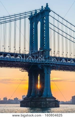 Sunrise shinning through the arch supports of the Manhattan Bridge in New York City