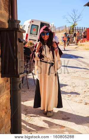 EL ACEBO DE SAN MIGUEL SPAIN - AUGUST 05: Girl with cassock during the way of St. James on August 05 2016
