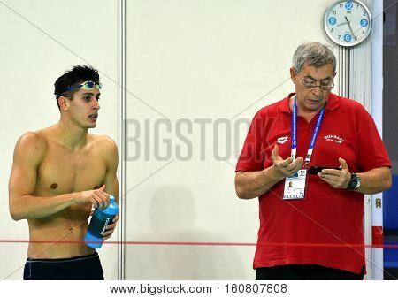 Hong Kong China - Oct 29 2016. Gergely GYURTA (HUN) with his coach Ferenc KOVACSHEGYI (HUN) after the Men's Individual Medley 400m Final. FINA Swimming World Cup Victoria Park Swimming Pool.