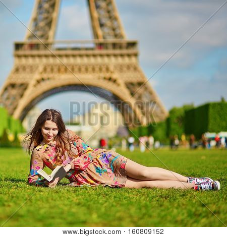 Beautiful Young Woman Near The Eiffel Tower
