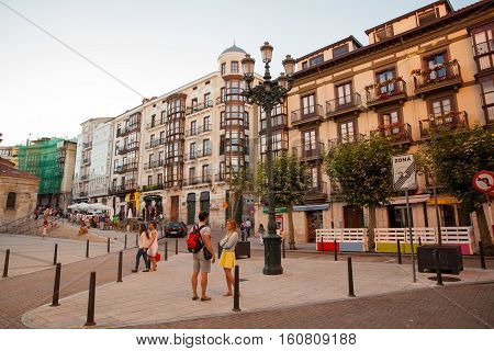SANTANTER SPAIN - AUGUST 02: Boy and girl talking in the square on August 02 2016