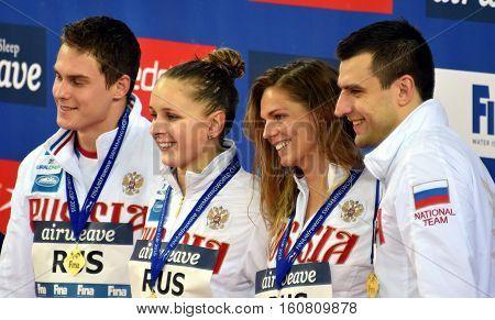 Hong Kong, China - Oct 29, 2016. Winner russian team (DONETC Stanislav, EFIMOVA Yuliya, MOROZOV Vladimir, USTINOVA Daria) at the Victory Ceremony of  Mixed 4x50m Medley Relay. FINA Swimming World Cup.