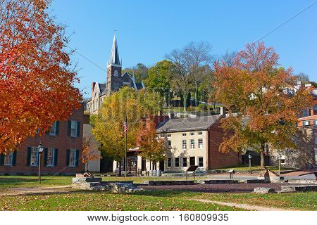 Harpers Ferry historic town in autumn West Virginia USA. St. Peter's Catholic Church and historic town buildings.