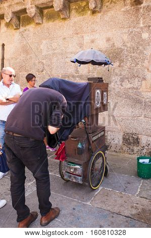 SANTIAGO SPAIN - AUGUST 17: Ambulant photographer in action in the Santiago square on August 17 2016